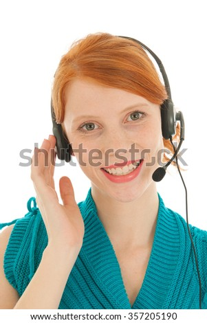 Portrait red haired woman with headset at call center - stock photo