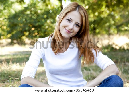 Portrait redhead girl at outdoor. Autumn. - stock photo