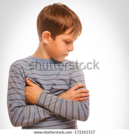 portrait sad child upset offended boy looking to the side in a striped sweater isolated on a white background large