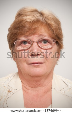 portrait senior woman on a gray background
