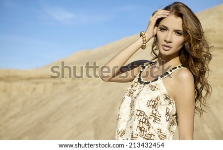 portrait sensuality brunette girl over sand background - stock photo