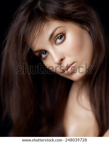Portrait series of a Caucasian woman on black background. Shot with defocused effect.