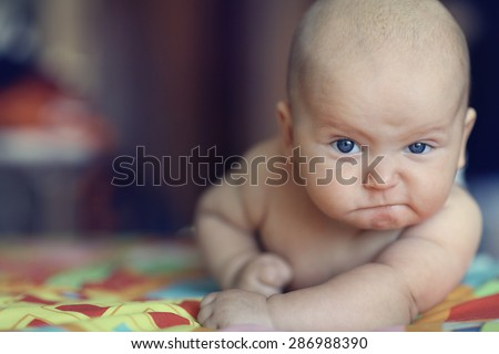 portrait serious stern baby - stock photo