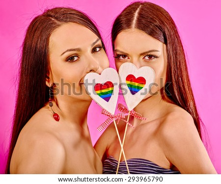Portrait sexy lesbian women with paper heart simbol. Isolated. - stock photo