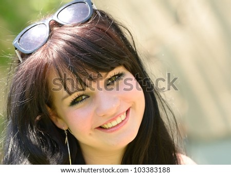 Portrait shoot of young pretty girl with sunglasses in her head.