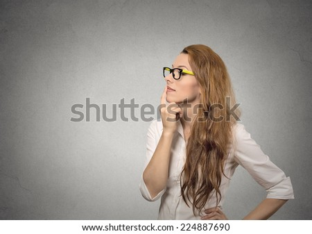 Portrait side profile happy beautiful woman thinking looking up isolated grey wall background with copy space. Human face expressions, emotions, feelings, body language, perception - stock photo