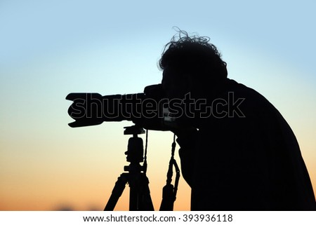 portrait silhouette photographer filmed the sunset in field summer