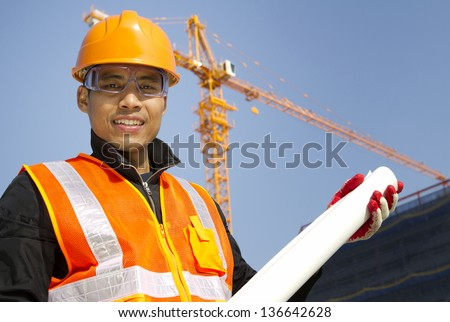 Portrait site manager with safety vest under construction - stock photo