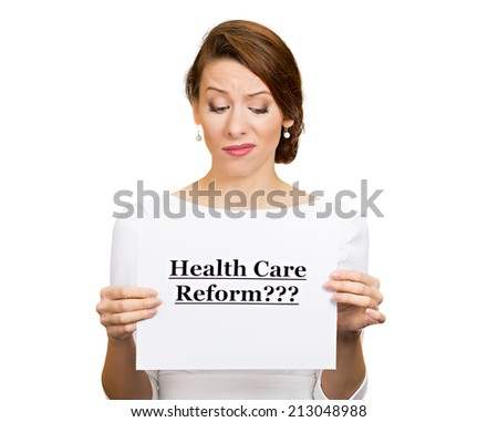 Portrait skeptical female, citizen, professional, doctor, holding sign health care reform? isolated white background. Obamacare, medicaid, legislation debate insurance plan coverage concept - stock photo