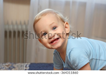 portrait smiling year old blonde girl with beautiful eyes