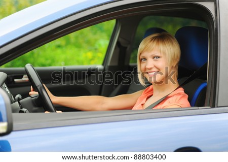 portrait  smiling young woman in the car - stock photo