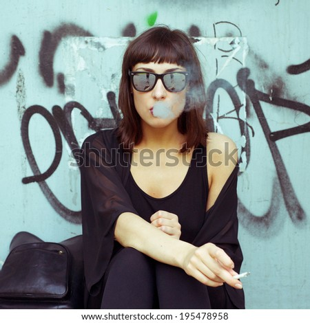 portrait smoking girl on the street - stock photo