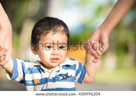 Portrait Soft focus and selective focus of little boy's Happiness when was walking trained by his mother and family in the garden   - stock photo