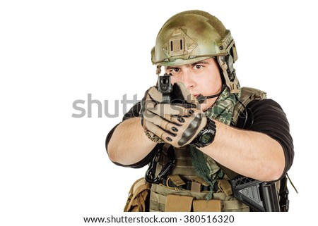 Portrait  soldier or private military contractor holding black gun. war, army, weapon, technology and people concept. Image on a white background.