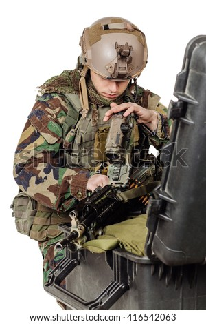 Portrait soldier or private military contractor repairing fix the rifle with the tool. war, army, weapon, technology and people concept. Image on a white background