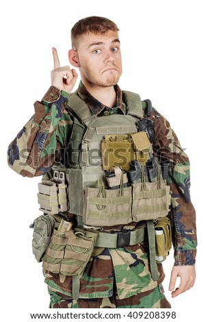 Portrait soldier or private military contractor showing finger and idea gesture. war, army, weapon, technology and people concept. Image on a black background.