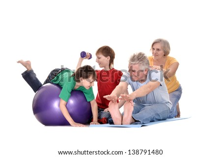portrait sporting children and their grandparents on a white background - stock photo