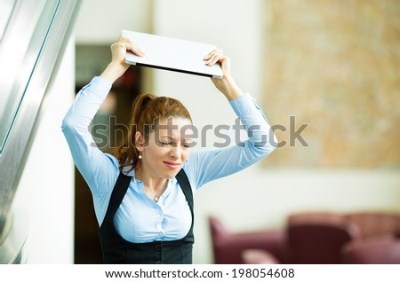 Portrait stressed, angry businesswoman throwing her tablet computer, laptop, isolated background corporate office. Negative human emotions, facial expressions, feelings, reaction, life perception - stock photo