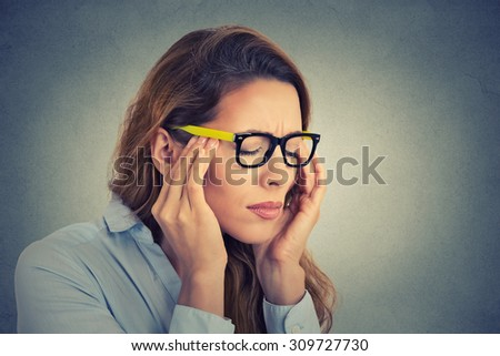 Portrait stressed young business woman having headache  - stock photo