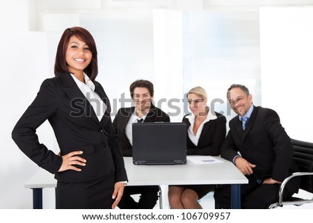Portrait successful business woman and her team
