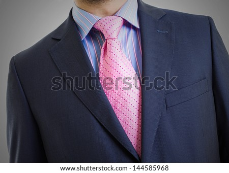 Portrait suit and tie close-up, leaning to the right - stock photo