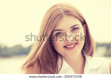 Portrait summer young girl outdoors. Closeup happy woman smiling on sunny summer or spring day outside in park by lake.  - stock photo