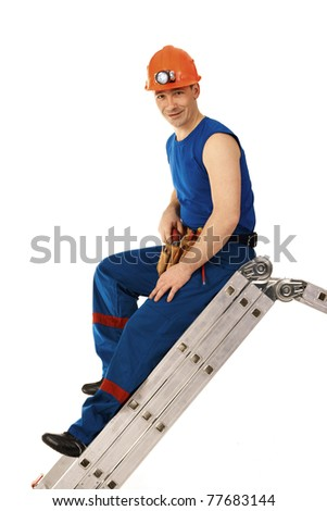 Portrait technician man in workwear with instrument and step-ladder - stock photo