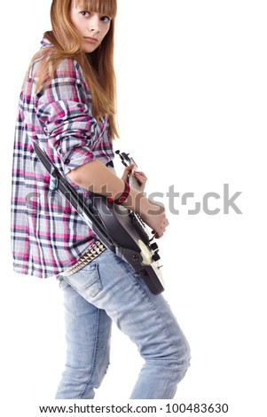 Portrait teen girl musician on electric guitar - stock photo