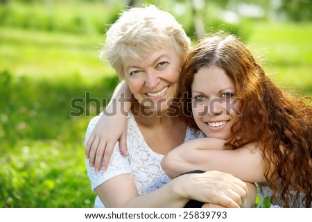Portrait the daughter and elderly mother in park