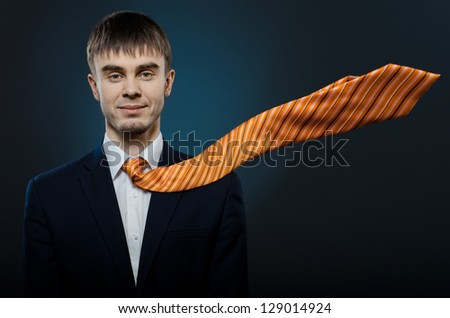 portrait  the  happy beautiful  businessman careerist in costume and orange necktie - stock photo