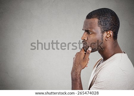 Portrait thoughtful young man  - stock photo