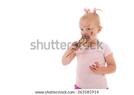 Portrait toddler girl eating chocolate ice cream isolated over white background - stock photo