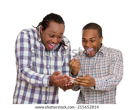 Portrait two men looking excited with opened mouth on cell phone watching football game, reading sms, e-mail viewing latest news, isolated white background. Positive human emotions, facial expressions - stock photo
