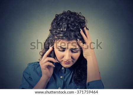 Portrait unhappy young woman talking on mobile phone looking down. Human face expression, emotion, bad news reaction - stock photo