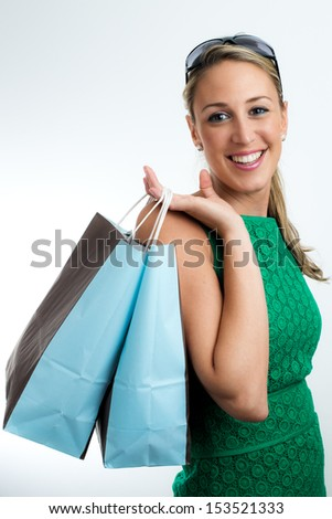 Portrait vertical of young happy smiling woman with shopping bags
