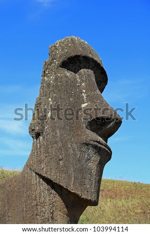 Portrait view of an ancient moai sculpture on Easter Island - stock photo