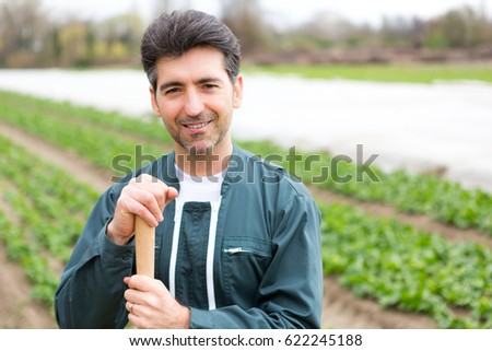 Portrait view of an attractive middle aged farmer working on a field - Nature concept