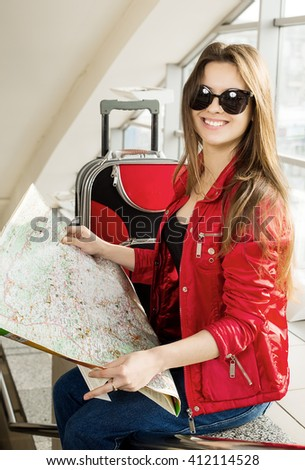 portrait woman looking at the map and telephone number. She is studying the route. Close-up. - stock photo