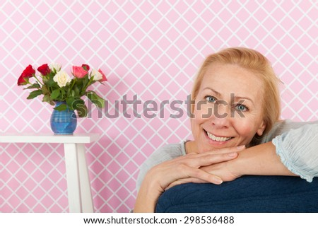 Portrait woman of middle age sitting in chair - stock photo