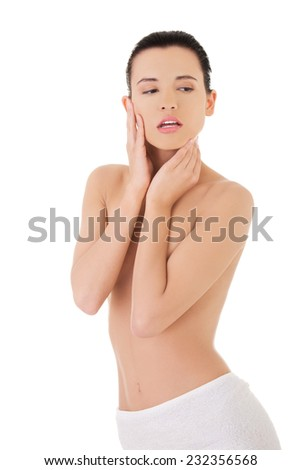 Portrait woman wrapped in towel touching chin.