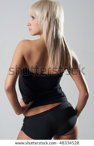 Portrait woman young blondy in studio in sporty underwear