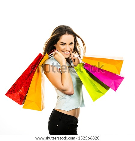 portrait young adult girl with colored bags - stock photo