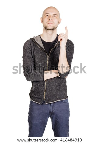 portrait young bald man pointing up, showing something, having an idea. emotions, facial expressions, feelings, body language, signs. image on a white studio background. - stock photo