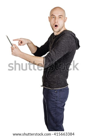 portrait young bald man using tablet computer. emotions, facial expressions, feelings, body language, signs. image on a white studio background. - stock photo