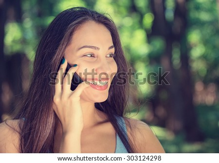 Portrait young beautiful woman talking on mobile phone. Face with toothy smile - stock photo