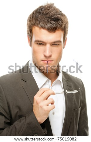 portrait young businessman thinking and keeps the glasses to his mouth isolated on white background - stock photo