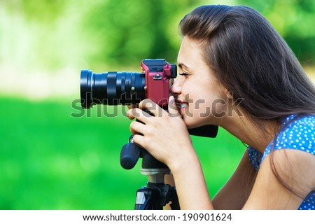 portrait young charming woman camera smiling background summer green park