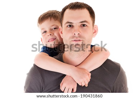 portrait young father with his son on back - stock photo