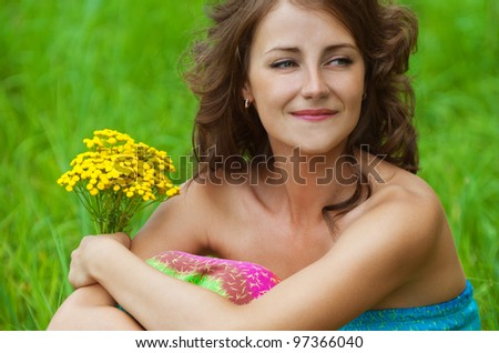 portrait young gay beautiful woman holding bouquet yellow wildflowers background summer green meadow