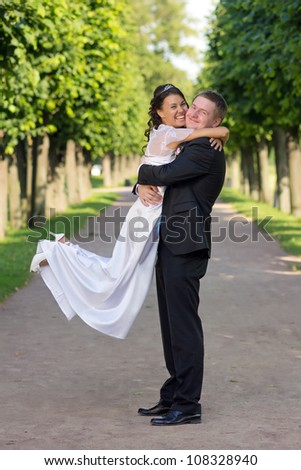Portrait young happy bride and groom outdoor - stock photo